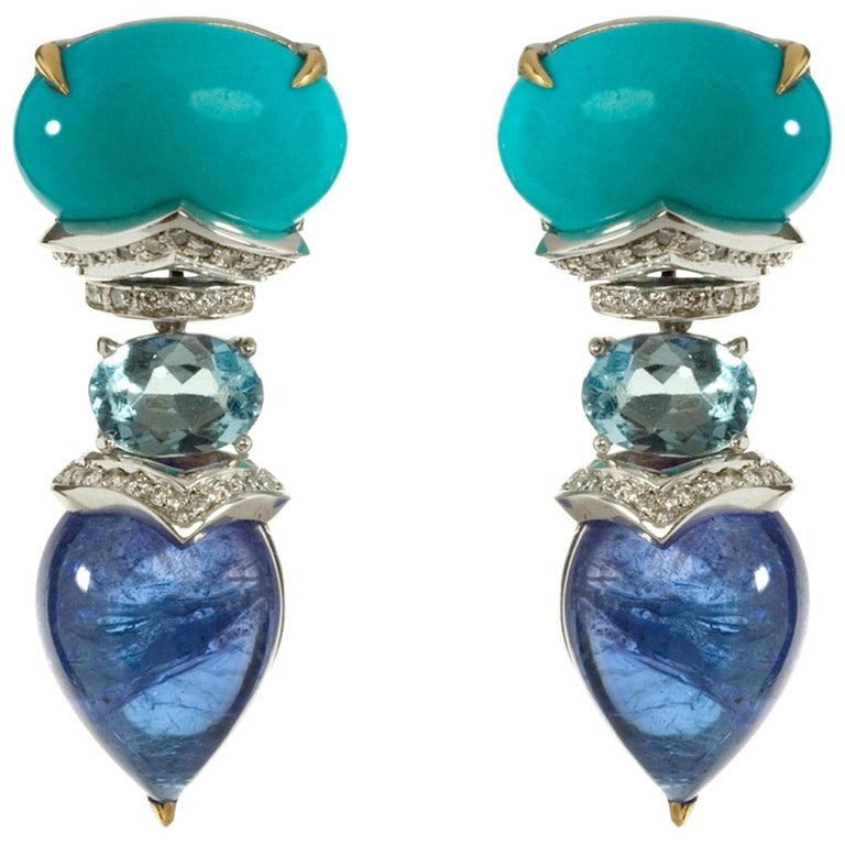 6.30g 18kt White Gold 62 White Diamonds VVS-G (0.32ct) 27.37ct total other gemstones  These stunning earrings are made up three distinct and empowering stones, each cut in a different way. The Cabochon Cut Turquoise that crowns the Earrings leads