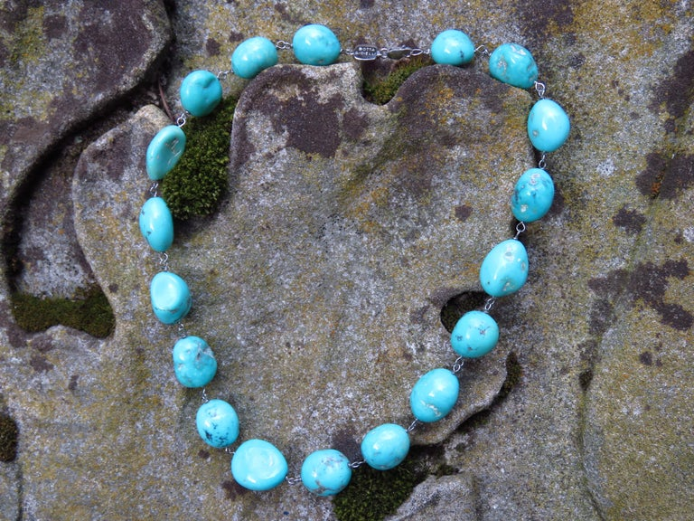 Unbelievable blue color natural nuggets torquoise necklace in 18k white gold. This stunning necklace is a great addition to your resort wear. Total length is 420 millimeters / 16.53 inches. It is stamped with the Italian Gold Mark 750 - 716MI. Ready