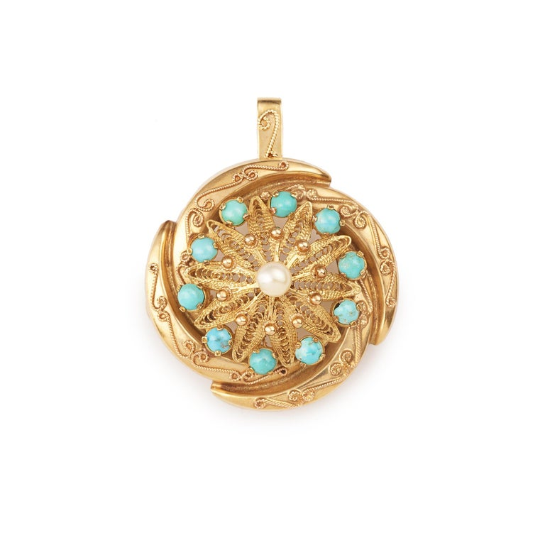 Beautiful brooch set with a pearl and ten cabochon turquoises.  The brooch can be worn as a pendant thanks to a removable bail.   14K yellow gold (14K hallmark)   One of a kind piece !!  Dimensions of the brooch : 3.2 x 1.67 cm (1.18 x 0.39