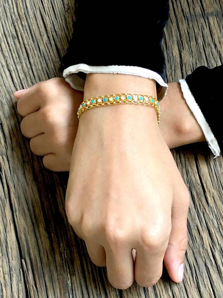 Unique vintage link bracelet in 18 K gold  with turquoises and pearls.   Brand : 5 OCTOBRE Designer : Sophie Pfeffer