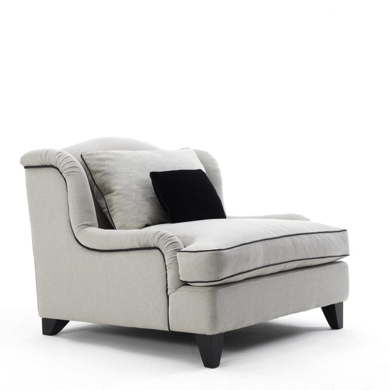 Old-fashioned glamour and exquisite craftsmanship create the ultimate lounging chair, an ideal addition to a classic living room, modern study or bedroom. The solid wood structure comprises feet in beechwood and is accented with the gentle curves of