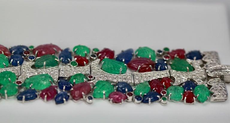 Art Deco Tutti Frutti Carved Stones Diamond Bracelet 18 Karat Wide For Sale