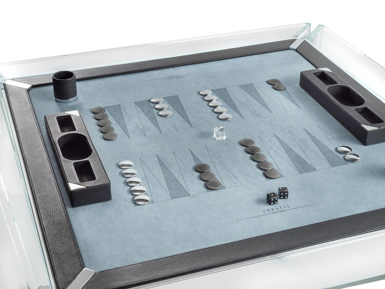 The Tuttuno leather edition backgammon game table is designed to accommodate two players with a built-in backgammon playing surface. The minimalistic design gives off the unique impression that the table is floating.  This Tuttuno table features a