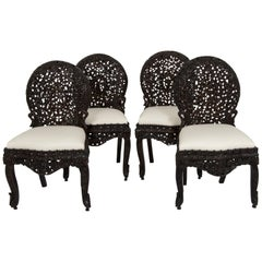 Twelve 19th Century Anglo-Indian Carved Dining Chairs