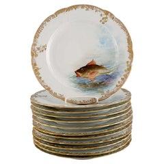 Twelve Antique Pirkenhammer Porcelain Dinner Plates with Hand-Painted Fish