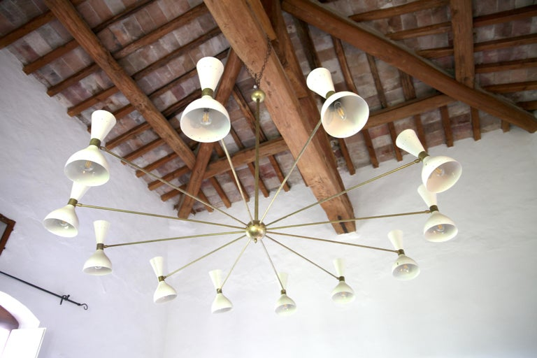 Twelve Arms Natural Patina Brass Chandelier, Ivory Pivoting Heads, Twin Bulbs For Sale 3