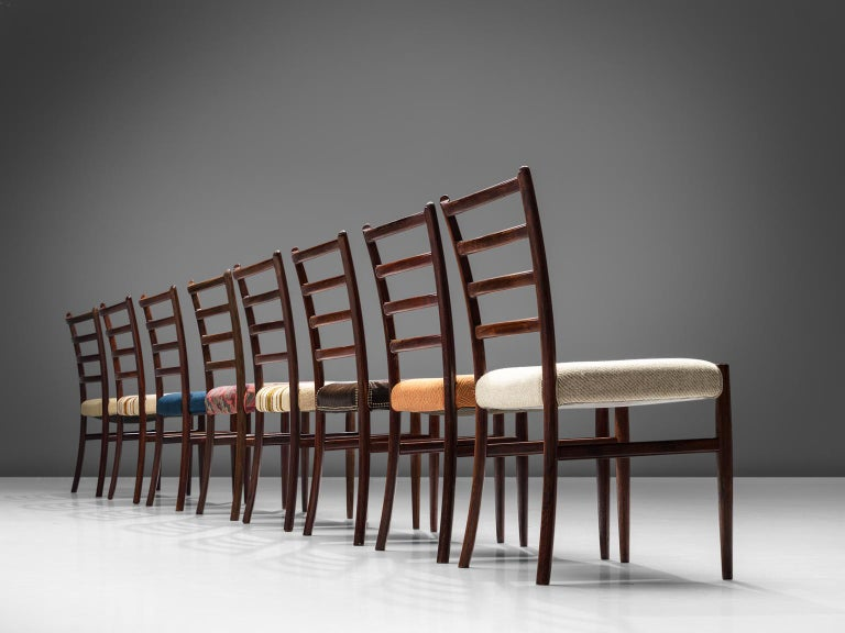 Scandinavian Modern Twelve Danish Rosewood Dining Chairs For Sale