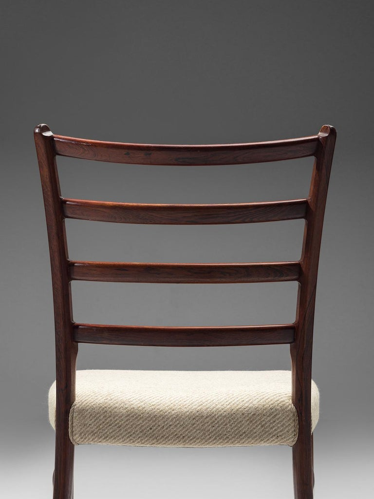 Fabric Twelve Danish Rosewood Dining Chairs For Sale