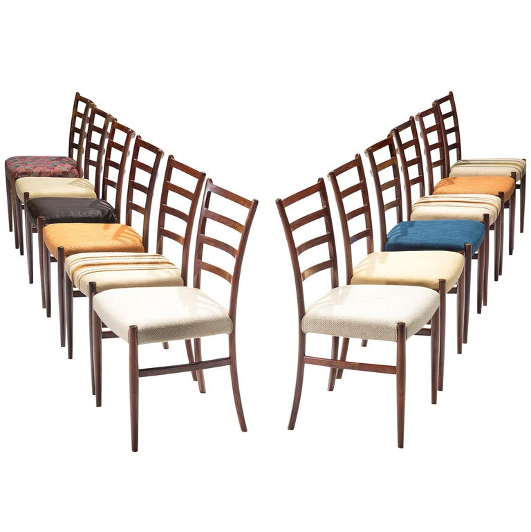 Twelve Danish Rosewood Dining Chairs For Sale