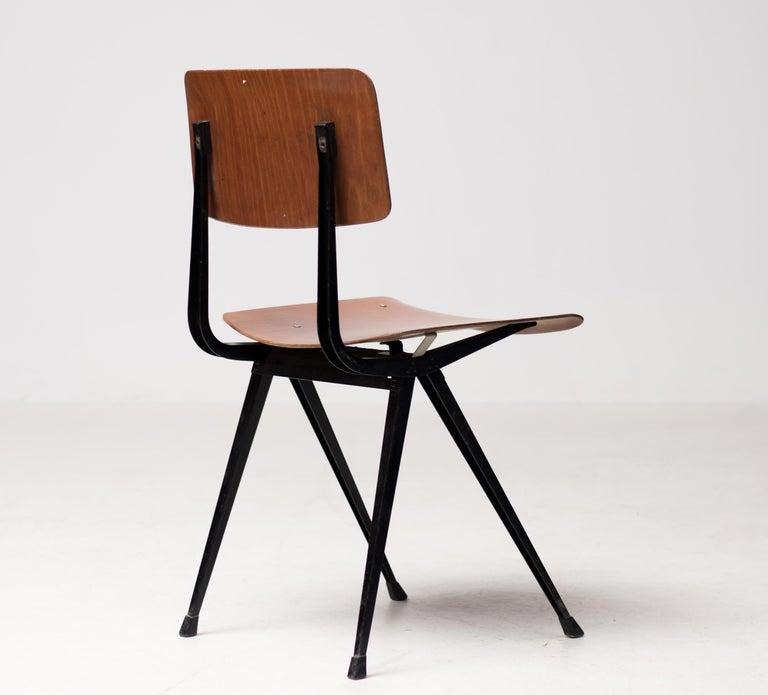 Set of twelve Result chairs, designed by Friso Kramer for Ahrend-De Cirkel in 1952. Innovative black bent sheet steel frame with pressed wood seat and back. Embossed logo.