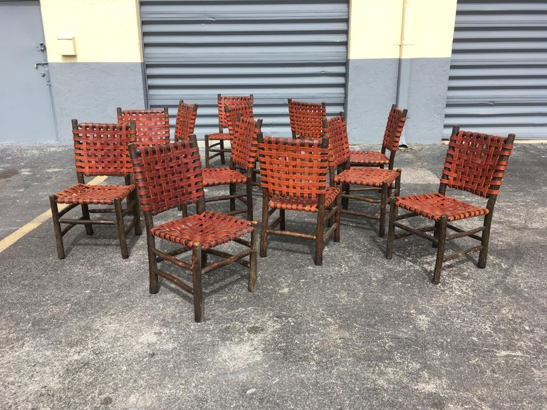 Twelve Old Hickory Dining Chairs with Woven Cognac Saddle Leather For Sale 12