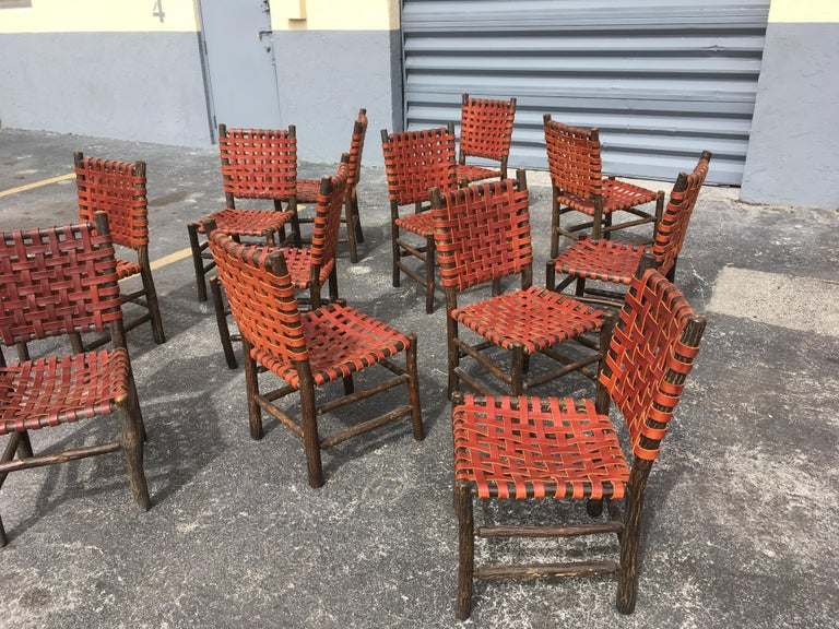Modern Twelve Old Hickory Dining Chairs with Woven Cognac Saddle Leather For Sale