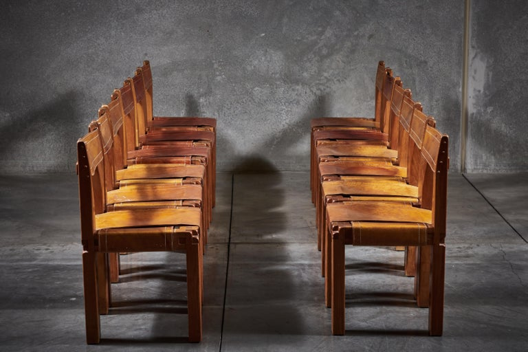 Patinated leather and elmwood S11 chairs by Pierre Chapo. Made in France circa 1966.