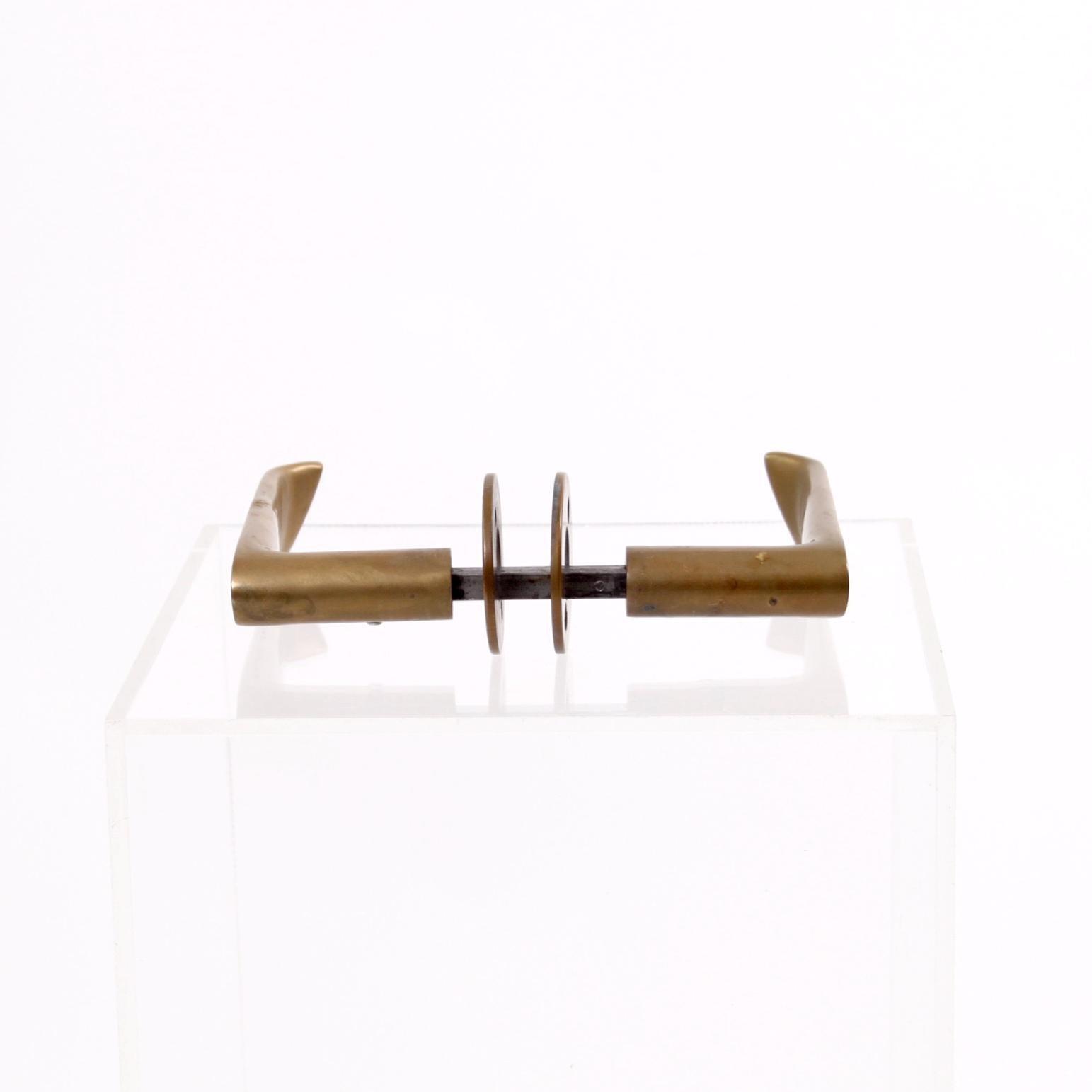 Twelve Sculptural Brass Door Handles By Alvar Aalto