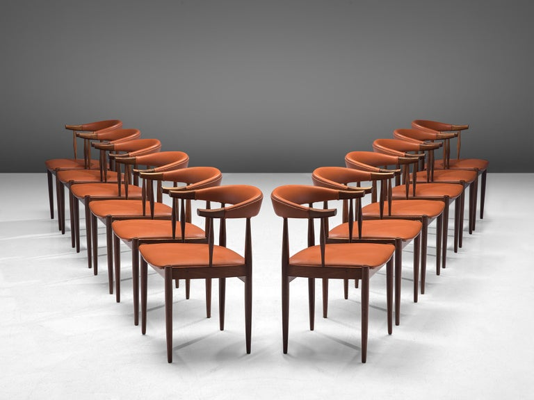 "Johannes Andersen, 12 'Bull Horn' chairs model BA113, rosewood, fabric and leather, Denmark, late 1960s  Large number of elegant ""Bull Horn"" BA113 chairs in rosewood, designed by Johannes Andersen. The chairs feature a sculpted backrest, upholstered"