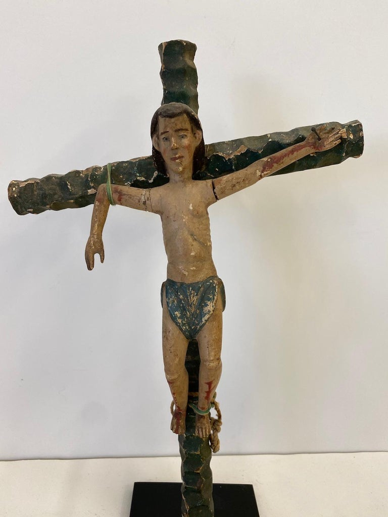 Two carved wooden figures on wooden crosses, from the Crucifixion of Christ story. They represent