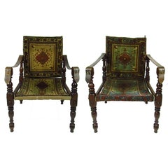 Two 19th Century Rug Upholstered Campaign Chairs