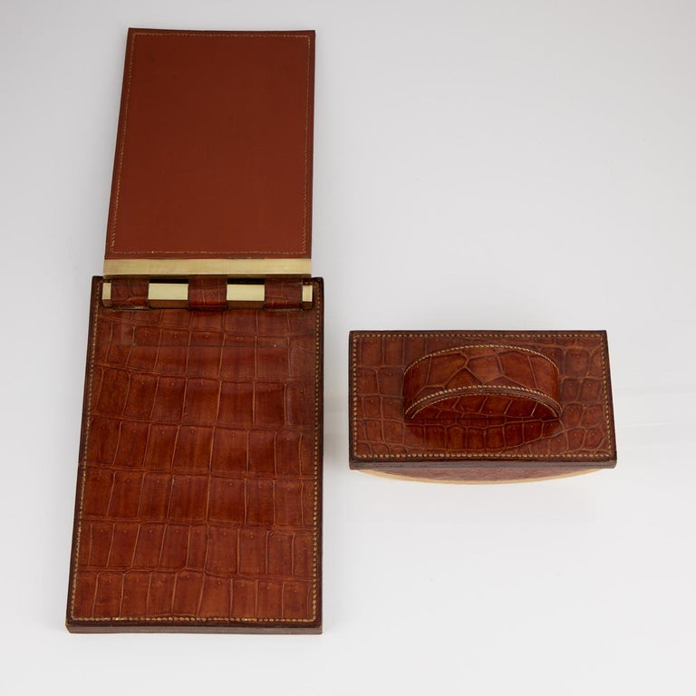 """Two beautiful and desirable vintage desk pieces by the most famous luxury brand, the crocodile skin still has its original sheen and is in very good condition.  Both pieces have stitching on the outer edges.  Measures: Blotter W 7 1/4"""" x H 4"""" x"""