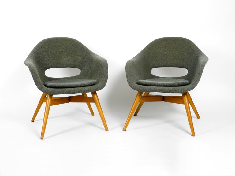 Pair of rare Mid-Century Modern 1960s lounge chairs by Miroslav Navratil with  fiberglass shell and original cover. A classic Made in the Czech Republic. Frame made of solid wood and plywood. Very high quality manufactured.  Very good seating