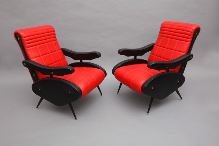 Two armchairs, Style of Marco Zanuso, Italy, 1958. Adjustable armchairs, black and red leather,  black legs with brass shoes.
