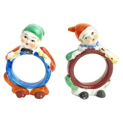 Two Adorable Figural Towel Ring Holders