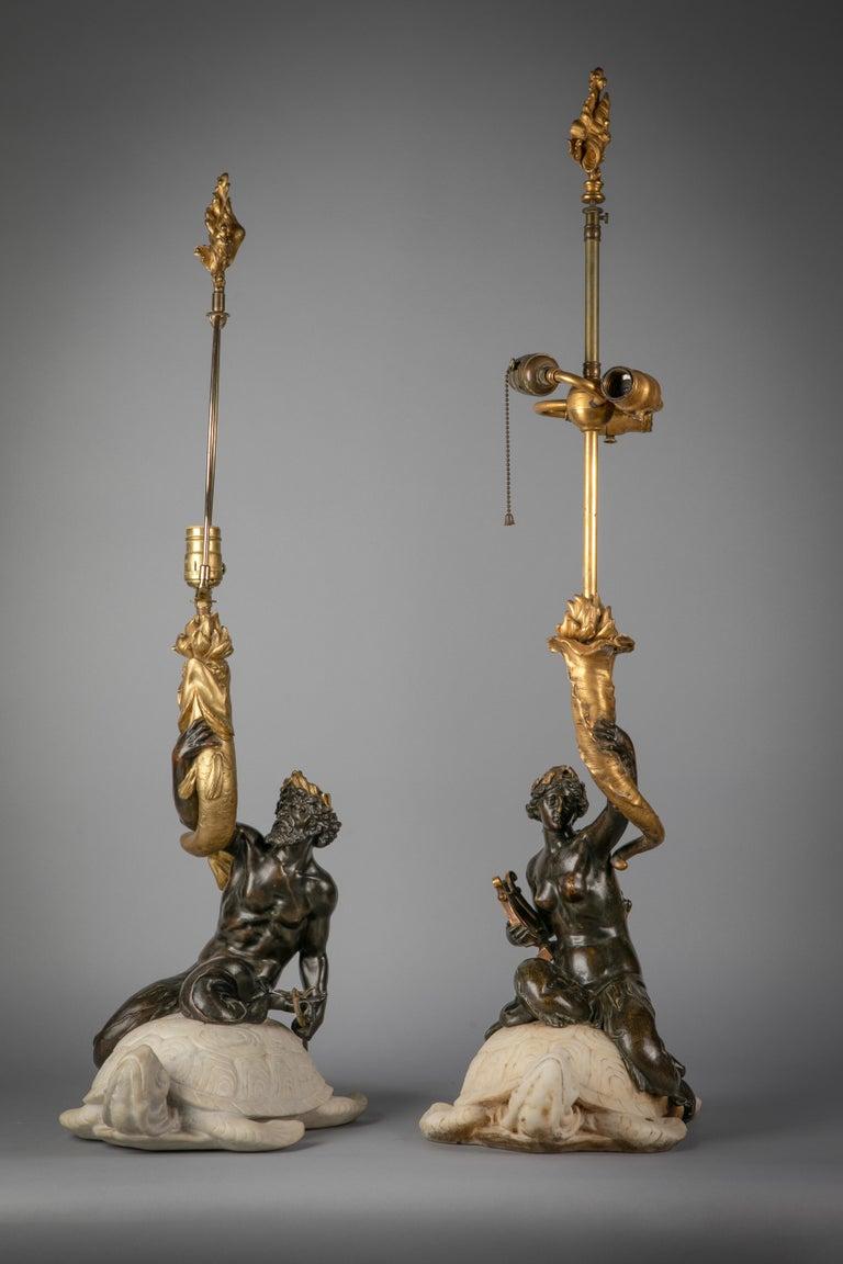 Modelled as Amphitrite and Poseidon each mounted on a marble sea turtle.