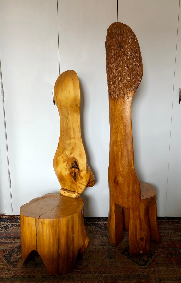 Artisan chairs circa 1960s, in the style of JB Blunk, one carved from a single redwood log, the other from a Cypress log, the taller redwood chair is initialed JB on the leg, with wonderful chip carved decoration on the back. Both are expertly