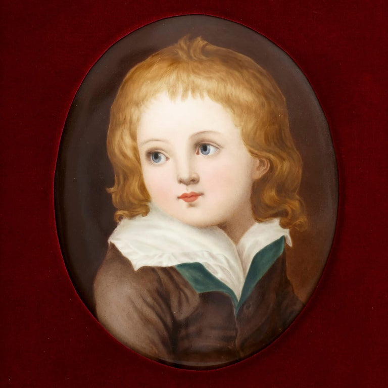 This pair of portraits are of oval form and depict the half-length figures of a young boy and girl. The boy has fair, shoulder-length hair and wears a white shirt and green-lined brown overcoat. He turns to his right and gazes off into the distance.