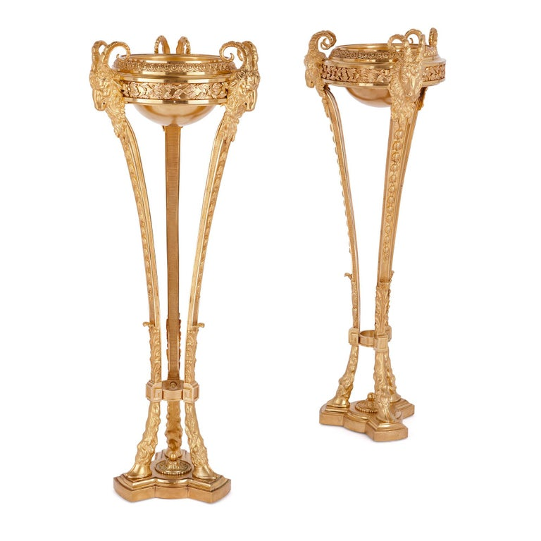 Two antique Neoclassical style gilt bronze tripod stands  For Sale