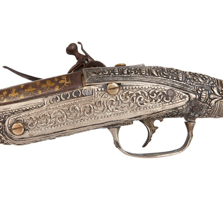 Islamic Two Antique Silver and Gold-Damascened Holster Pistols For Sale