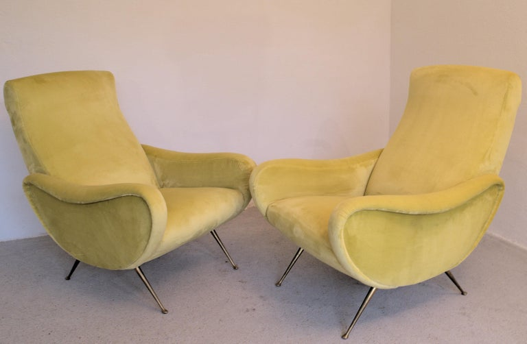 Two armchairs in the style of Marco Zanuso.   From a villa in the lake area, completely restaured, padding replaced, belt replaced and upholstered with an Italian woven canary yellow high pile soft writing velvet.   Upholsterer/restaurer said it