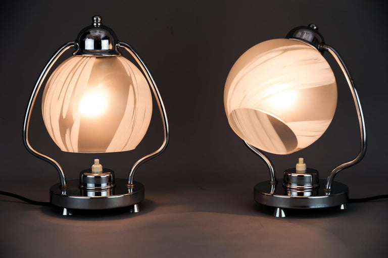 Two Art Deco chrome table lamps 1920s with original glass shades Original condition.