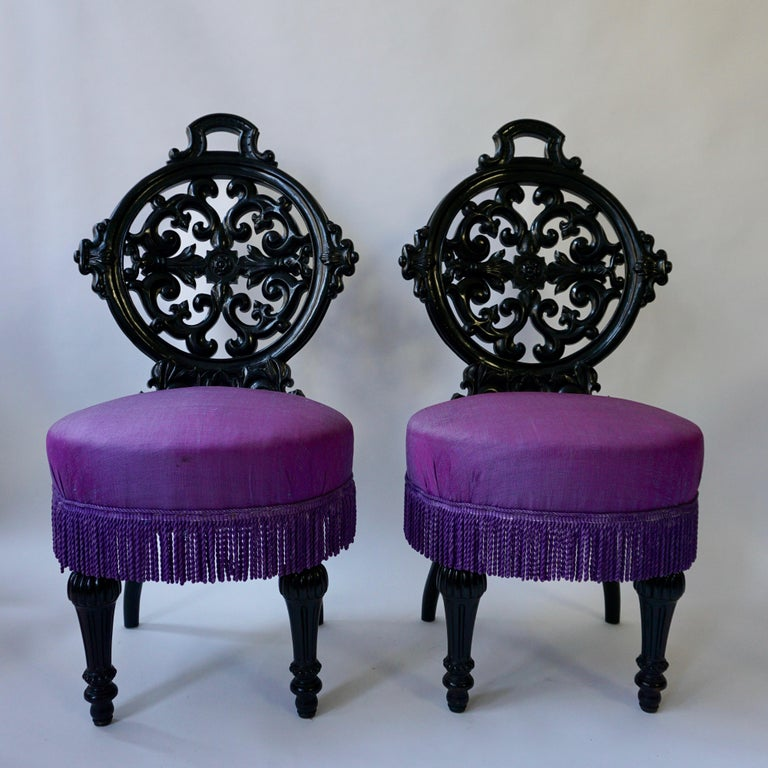 Two black mid-Victorian rococo revival side chairs with upholstery. Netherlands. Measures: Height 95 cm. Seat height 46 cm. Width 50 cm. Depth 56 cm.