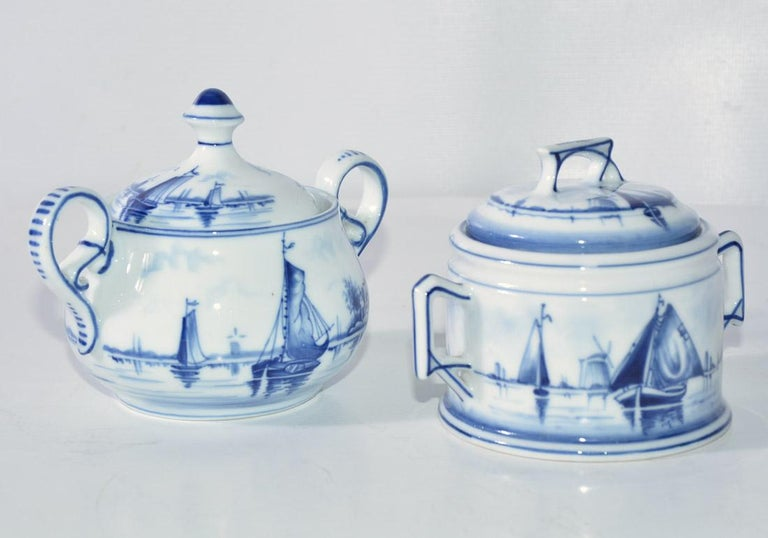 The two different blue and white vintage sugar bowls are stamped