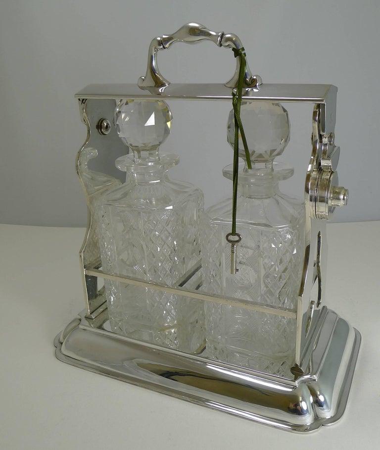 Two Bottle Tantalus Or Lockable Liquor Frame By John