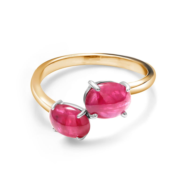 Fourteen Karats white and yellow gold double, two, cabochon ruby facing ring Two cabochon Burma ruby weighing 3.90 carat Rubies hue tone color is of a firebrick red                                                                        Ring size