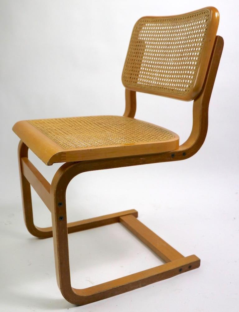 Italian Two Cantilever Cane and Bentwood Dining Chairs after Alto and Breuer For Sale