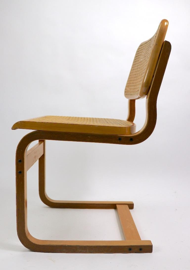 Two Cantilever Cane and Bentwood Dining Chairs after Alto and Breuer In Good Condition For Sale In New York, NY