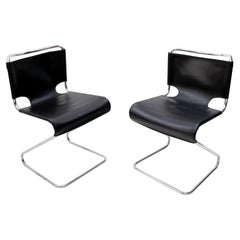 Two Pascal Mourque cantilever chairs model Biscia