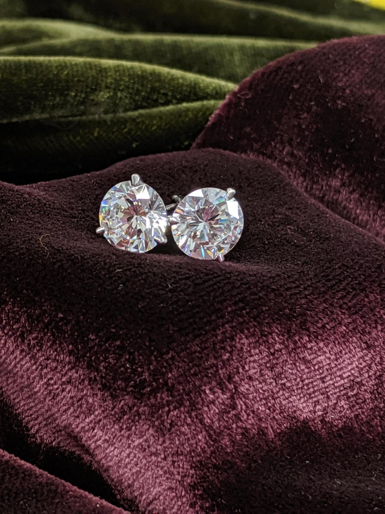 Custom mounted for you, these CLASSIC, clean, large and brilliant 4 carat total (2 carat each) Diamond Ear Studs are a staple in your luxury portfolio.  Our best offering of Round Brilliant Cut Diamonds come with GIA grading reports with the