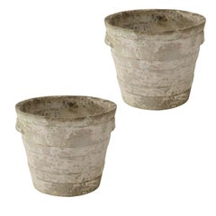 Two Cement Ribbed Urns