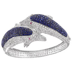 Two Dolphin Blue Sapphire and 15 Carat Diamond Bangle in 18 Karat White Gold