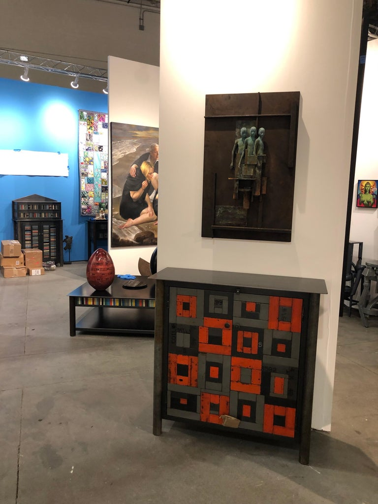 This totally functional modern industrial cabinet is created from hot-rolled steel and found painted panels is the ultimate example of sustainable design.  The color is original to the steel and uses salvaged and recycled materials.  In this case,