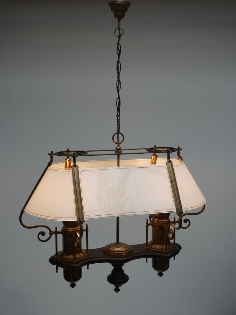 Two elegant glass, wood and copper pendant lights.