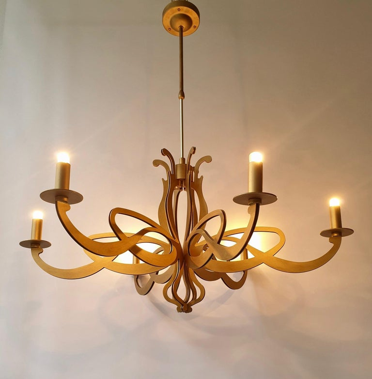 Two large elegant Art Nouveau chandeliers adjustable in height with an extendable telescope suspension system.  Measures: Maximum height 112 cm - 44