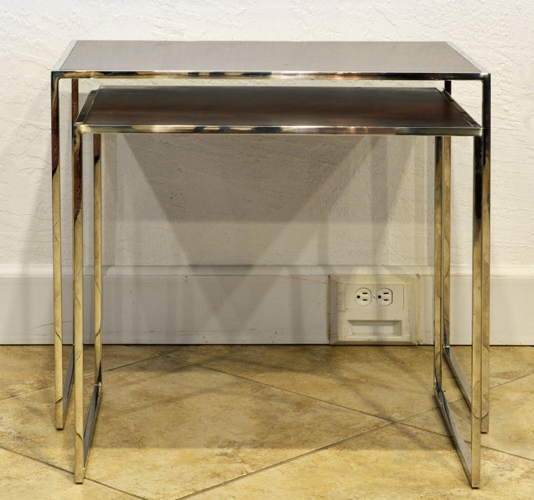 The tables features panel Santos Rosewood tops set in frames of polished stainless steel. A very elegant design by Michael Kirkpatrick who is known also for being leading designer for Ralph Lauren and Calvin Klein. The smaller table bears the Decca