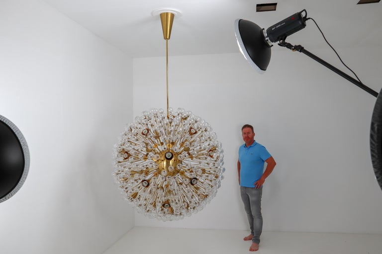 Two extreme large snowflake chandeliers in the style of Emil Stejnar for Rupert Nikoll, brass and glass, Austria, 1960s. Has a diameter of 50