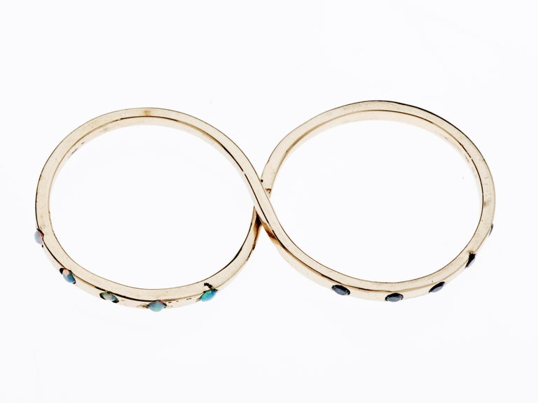 Opal Black Diamond Gold Two Finger Ring J Dauphin  J DAUPHIN Made in 14k Gold A Fashion ring which symbolize love and infinity  This piece comes in 3 sizes  (Size Us 5 and 6) (Size Us 6 and 7) (Size Us 7 and 8)  (The rings has two loops which goes
