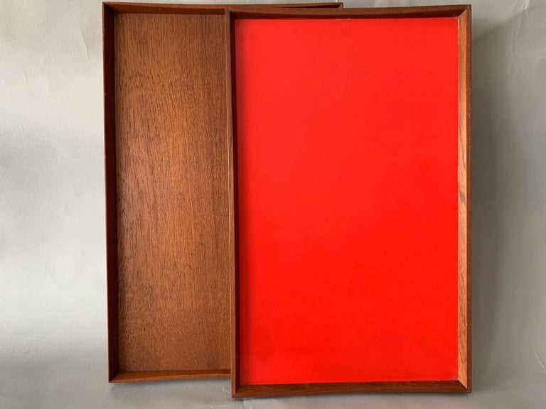 Two trays-one reversible red/black the other all teak designed by Finn Juhl for Torben Orskov, circa late 1950s. Not that they are slightly different sizes, one is marked