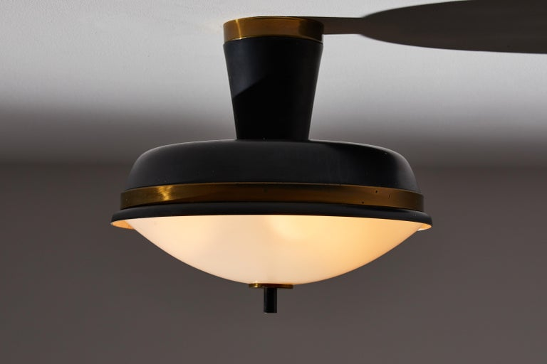 Two flush mount ceiling lights by Oscar Torlasco for Lumi. Designed and manufactured in Italy, circa 1960s. Satin glass diffusers, brass, enameled aluminum structure. Rewired for U.S. junction boxes. Each light takes three E27 European candelabra